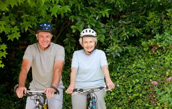 @Glowimages: Senior couple mountain biking outside
