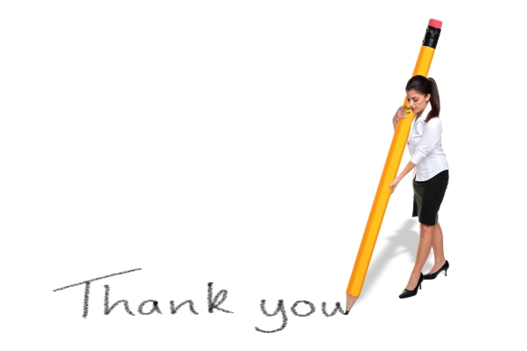 @Glowimages: Businesswoman writing Thank you with giant pencil
