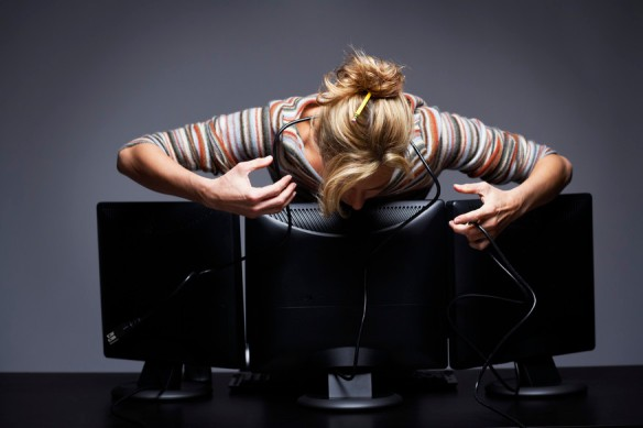 @Glowimages: Frustrated Office Worker Using Computers