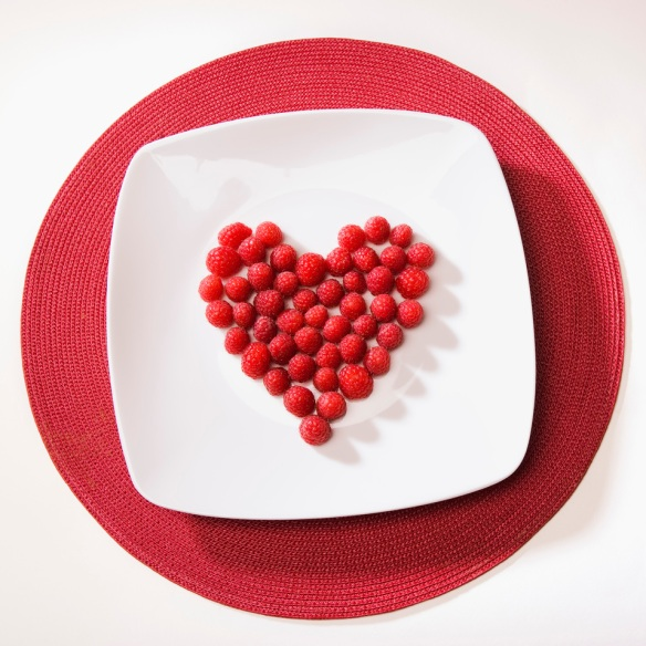 @Glowimages: Raspberries arranged in heart shape